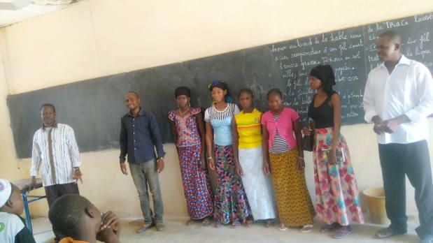 Principal of L'ecole Ouolodo Secondaire Cycle, teacher, 9th grade scholars Awa, Fatoumata, Miriam and 8th grader Maimouma, Les Filles Unies President Fatoumata Coulibaly.